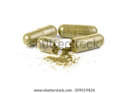 herb capsule with green herbal leaf isolated on white background - stock photo