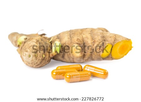 Herb capsule with turmeric on white background - stock photo