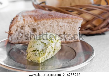 Herb-flavoured butter with bread - stock photo