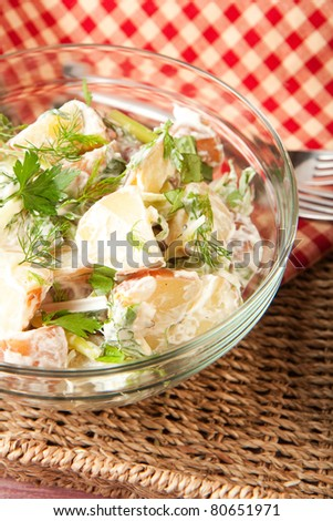 Herb potato salad in picnic setting - stock photo
