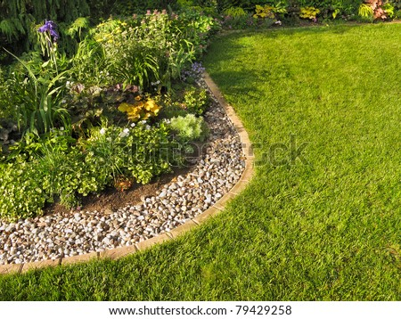 Herbaceous border and lawn - stock photo