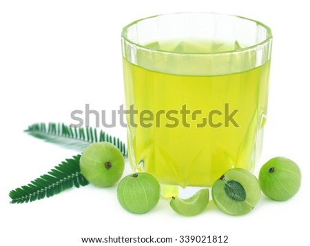 Herbal amla juice with fresh fruits over white background - stock photo