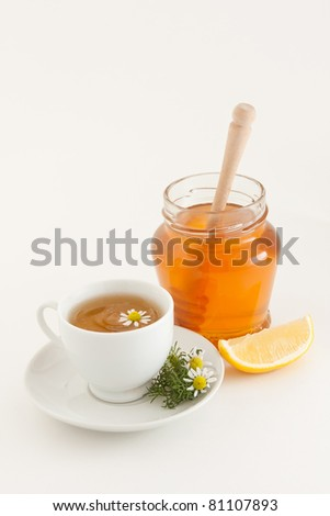 Herbal chamomile tea with honey and lemon - stock photo