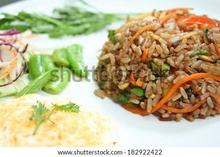 herbal fried brown rice - vegetarian thai food, healthy food - stock photo
