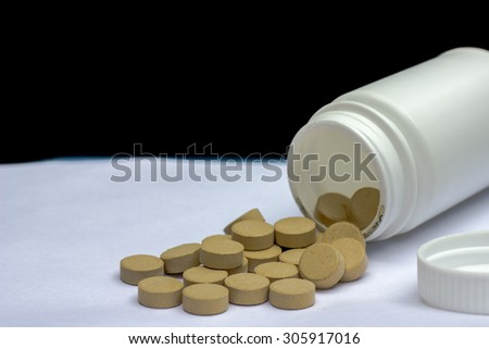 herbal green pill on white background - stock photo