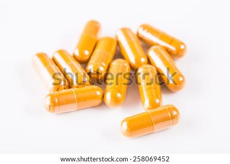 Herbal medicine capsule on white background. - stock photo