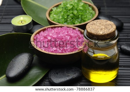 herbal salt with zen stone and leaf with massage oil set for spa - stock photo