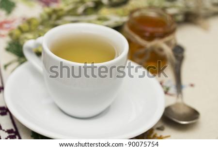 Herbal tea and fresh honey, shallow dof - stock photo