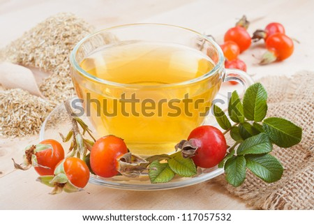 herbal tea and rose hips - stock photo