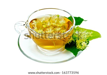 Herbal tea in a glass cup, fresh linden flowers isolated on a white background