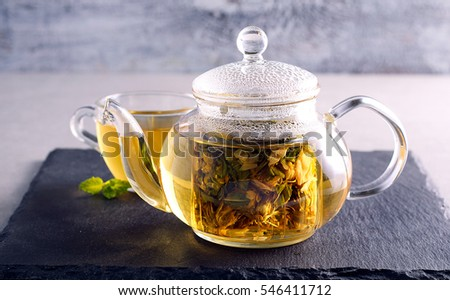 Herbal tea in a glass tea pot