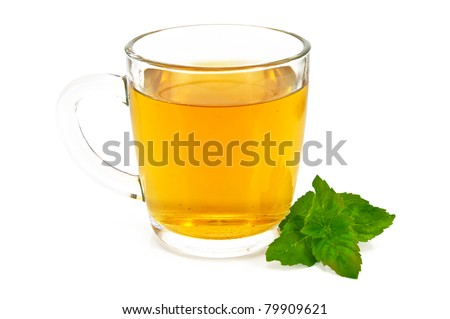 Herbal tea in a tall glass mug with a sprig of mint isolated on white background