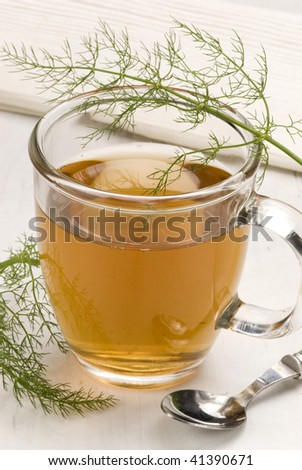 Herbal tea.Infusion in a glass cup.fennel.Foeniculum vulgare.Naturopathy.Selective focus.