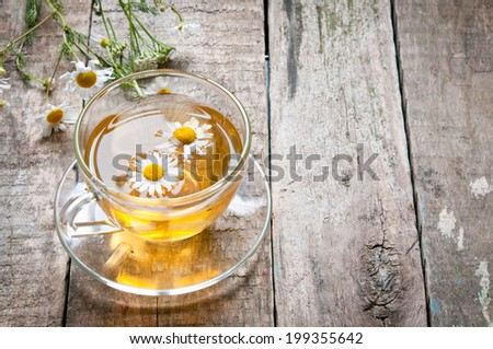 Herbal tea with a chamomile - stock photo