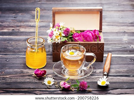 Herbal tea with honey and flowers. Wild herbs and flowers.  - stock photo