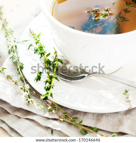 Herbal Thyme Tea in white dish, square - stock photo