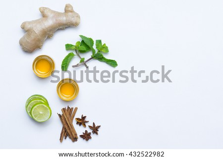 herbal with fresh mint, honey, lemon, ginger cinnamon on carpet background. Top view, copy space  - stock photo