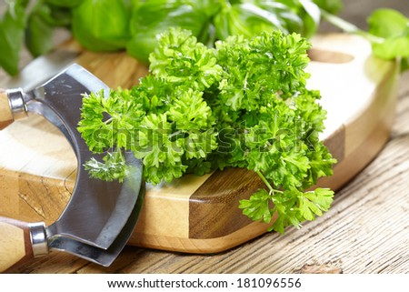 herbs and a knife on a cutting board