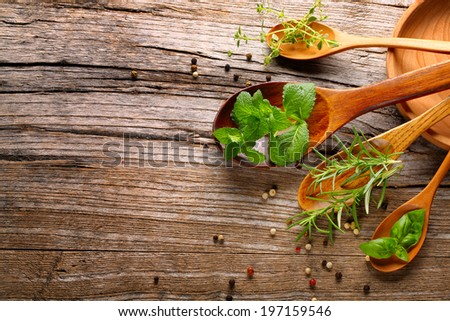 herbs and spice on wooden table - stock photo
