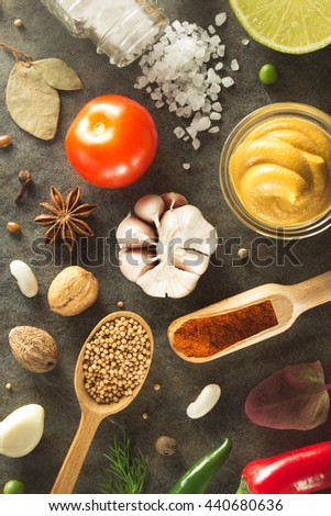 herbs and spices at table background - stock photo