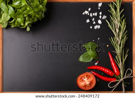 Herbs and spices. basil, red pepper, salt and rosemary on a black background. With space for text - stock photo