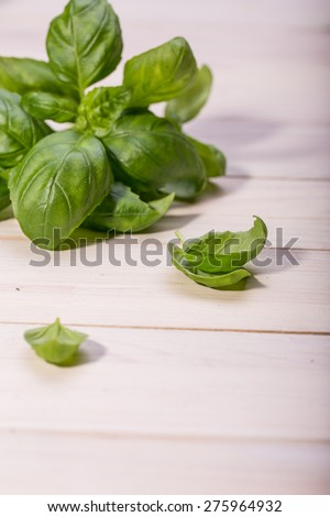 herbs and spices, fresh basil and parsley on wooden chopping board - stock photo