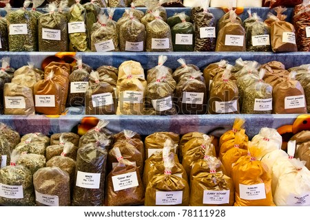 Herbs and spices on a market with flavors from all over the world - stock photo