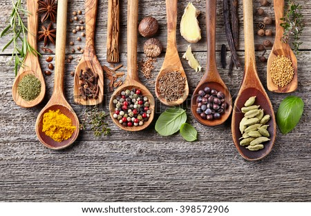 Herbs and spices on a wooden background - stock photo