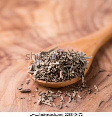 Herbs de Provence. Mixed dried herbs in spoon over wooden background, selective focus - stock photo