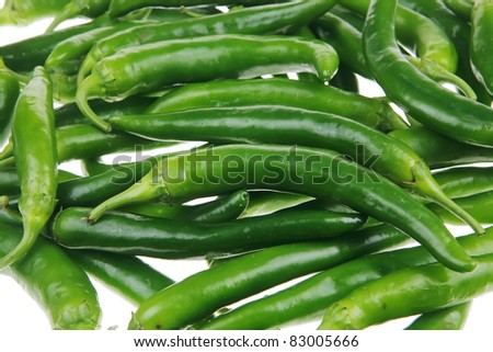 herbs : photo of a bunch of hot green chili peppers isolated over white background