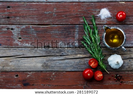 Herbs,spice, tomatoes and olive oil on rustic wooden table. Background with space for text. Cooking, vegetarian food or health concept - stock photo