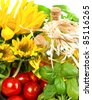 Herbs with tomatoes, sunflowers and bottle of oil - stock photo