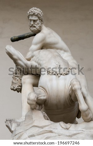 Hercules beating the centaur Nessus  statue in florence italy - stock photo