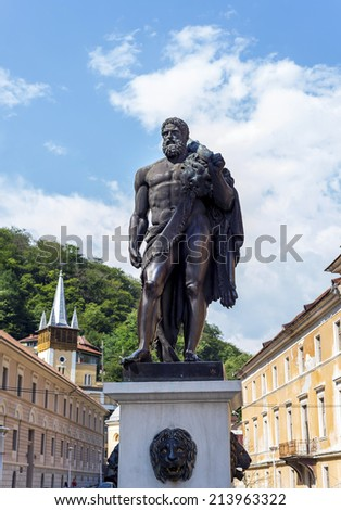 Hercules statue in spa town of Baile Herculane famous for its healing properties: hot springs with sulfur and other minerals. Legend has it that  Hercules stopped in the valley to bathe and rest. - stock photo