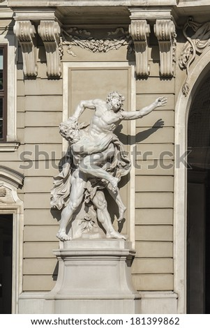 Hercules white stone statue in the southern entrance of Hofburg palace in Vienna, Austria, Europe. Hofburg Palace was residence of Habsburg dynasty, rulers of Austro-Hungarian Empire.
