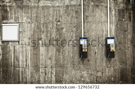 Here is 2 public phones and a blank board. You can link them to create some kind of communication. Feel free to put your idea on this little composition. - stock photo