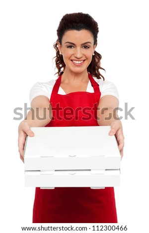 Here is your order sir. Hot pizza at your doorstep. Enjoy your meal. Woman delivering pizza - stock photo