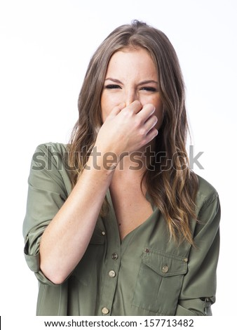 here smells bad. A young woman - stock photo
