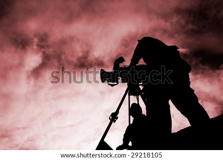 Here was a cameraman stand with silhouette. - stock photo
