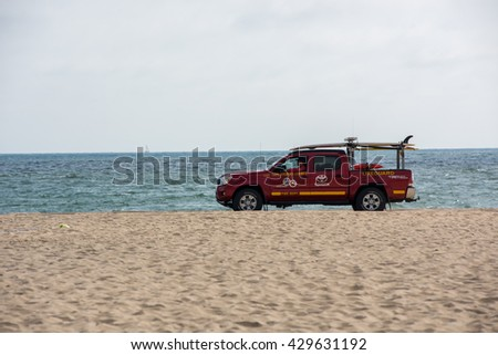 Hermosa Beach, CA/USA: May 30, 2016: Los Angeles County Lifeguard driving a Toyota Tacoma in Hermosa Beach on May 30, 2016.  Los Angles County has about 1,000 lifeguards. - stock photo