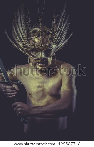 Hero, golden deity, man with wings and gold helmet - stock photo