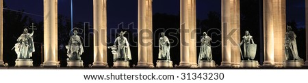 Heroes Square in Budapest, consists of two semi-circles with Hungarian kings and heroes figures - left side. Panoramic photo - stock photo