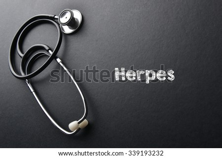 Herpes word with stethoscope - health concept. Medical conceptual