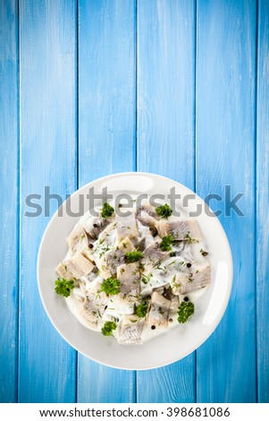 Herring fillets in cream - stock photo