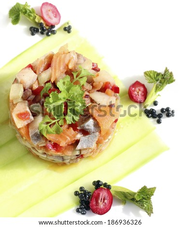 herring salad with smoked salmon and vegetables - stock photo