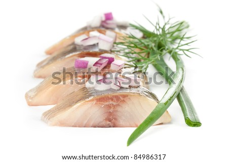 herring salt fillet with onion - isolated pieces - stock photo