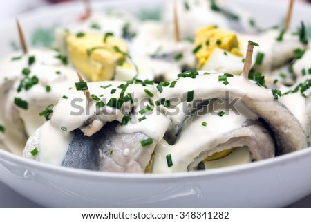 Herring with egg homemade. Flaps of herring wrapped with an egg in Polish. - stock photo