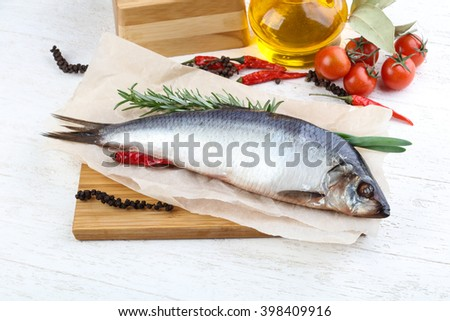 Herring with onion and rosemary on the wood background - stock photo