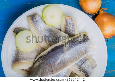 Herring with onions - stock photo