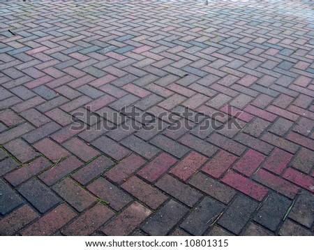 Herringbone pattern pavement making a great background - stock photo